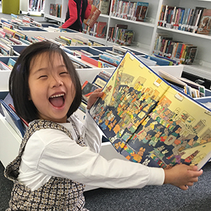 American School of Paris - Lower School happy child in library